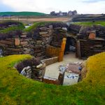 skara brae in foreground skaill house manor in distance