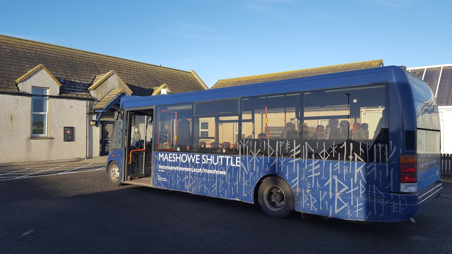 blue bus with maeshowe shuttle decal sat in front of visitor centre