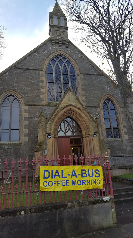 Kirkwall East Church with DIAL A BUS banner infront