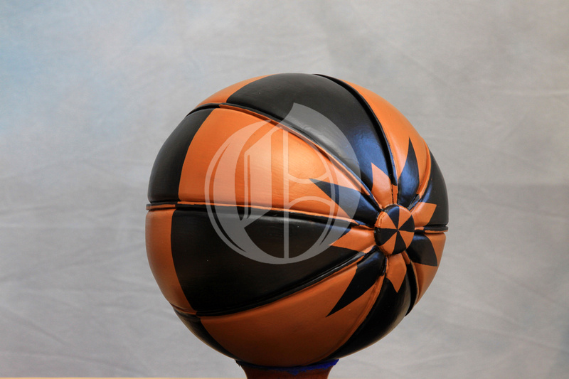 the ba' is a leather ball black and orange