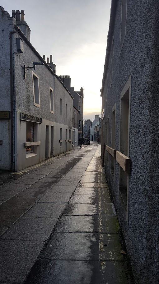 victoria street showing barricaded shops a tradition in December in orkney