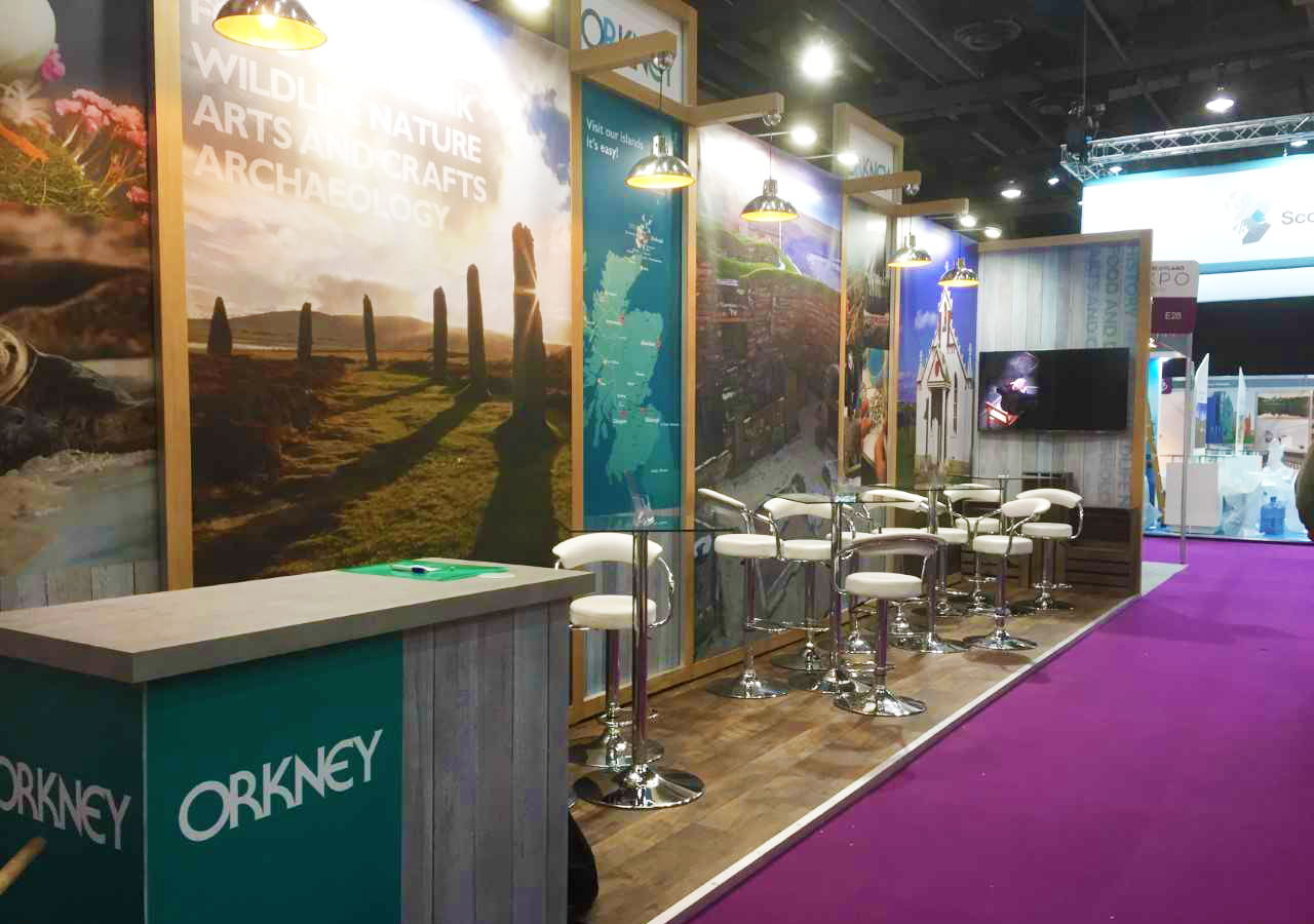 destination Orkney stand at visit scotland expo 2019 decorated with images of iconic orkney sites