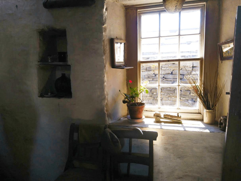 sun streaming through the farmhouse window of Corrigall Farm Museum